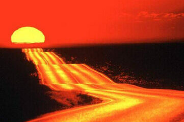 photo of a road at sunset