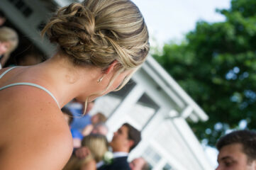 photo of the back of a girl with her hair in an updo