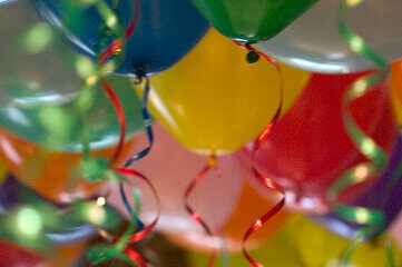 photo of party balloons with curly ribbons