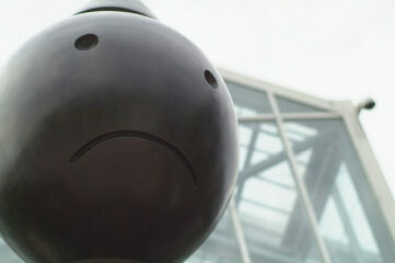 photo of frowny face on statue