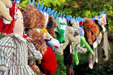 photo of stuffed animals hanging on clothes line