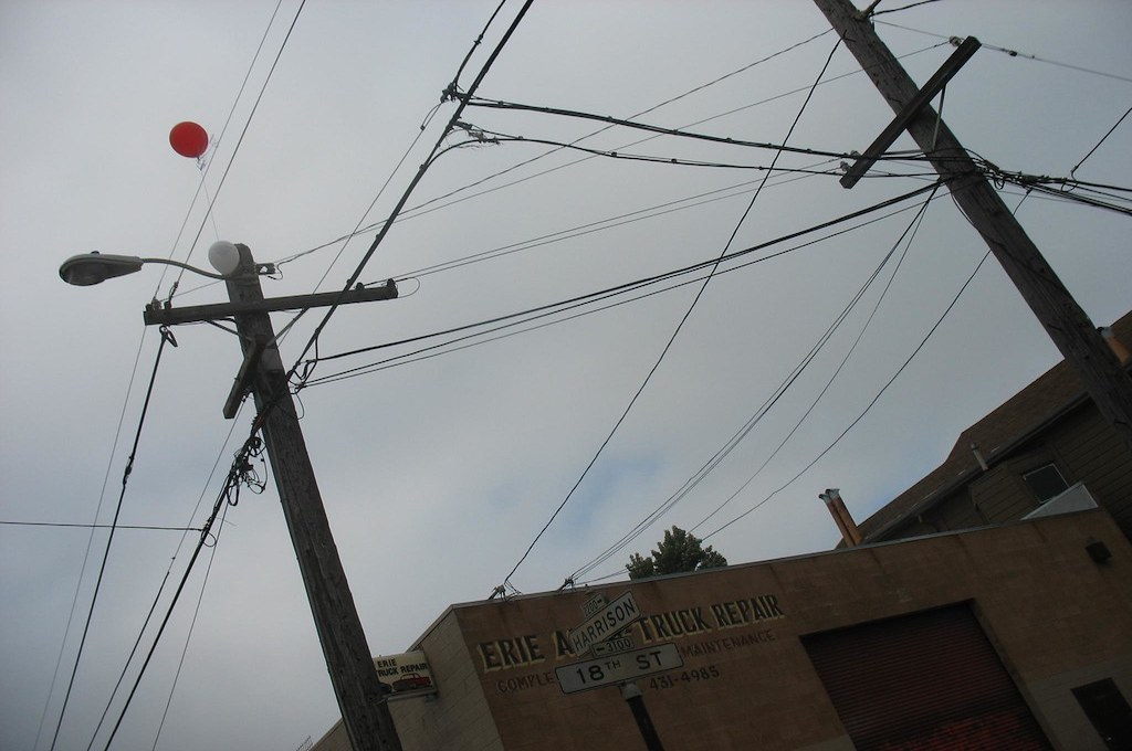 photo of balloons stuck in overhead electrical wire