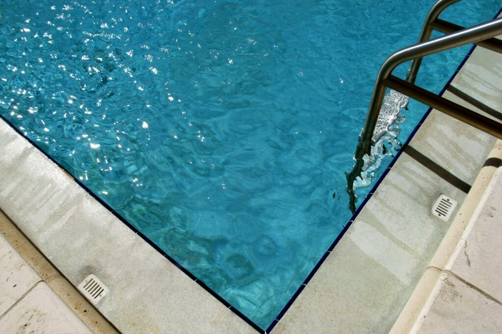 photo of pool with pool ladder