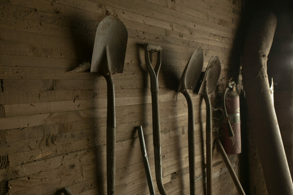 photo of a wall of shovels