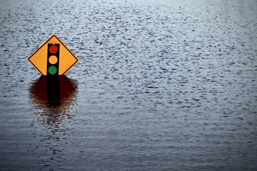 photo of street sign on flooded street